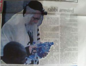 Rabbi Berland arrested handcuffs