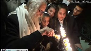 Rav Berland lighting menorah in South Africa