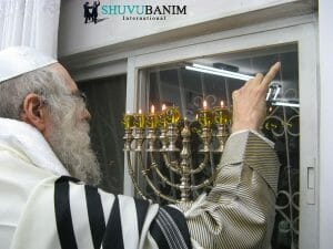 Rav Berland light Chanukah Menorah in his home in Jerusalem