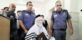rav-berland-in-court-surrounded-by-police-in-wheel-chair