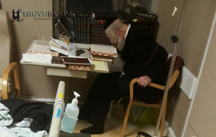 Rav Berland studying Torah in Hadassah hospital immediately after a serious operation
