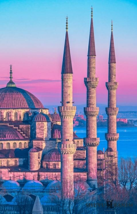 A pink and blue image of a castle in Istanbul