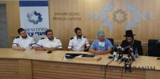 Medical personnel sitting with Gavriel Lavie at the press conference at Shaarei Tzedek hospital