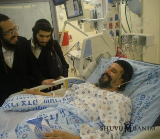 Gavriel ben Ines in hospital bed. You can clearly see stab wounds on his face.