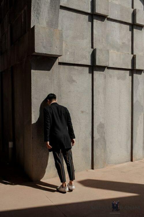 Man bashing his head against a stone wall
