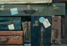 Old suitcases arranged next to each other.
