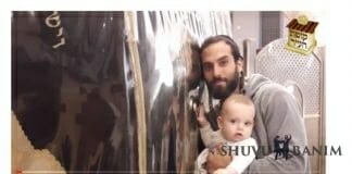Picture of Yitzhak Amar with his baby, by the tomb of Rebbe Nachman