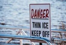 Sign next to a lake saying Danger