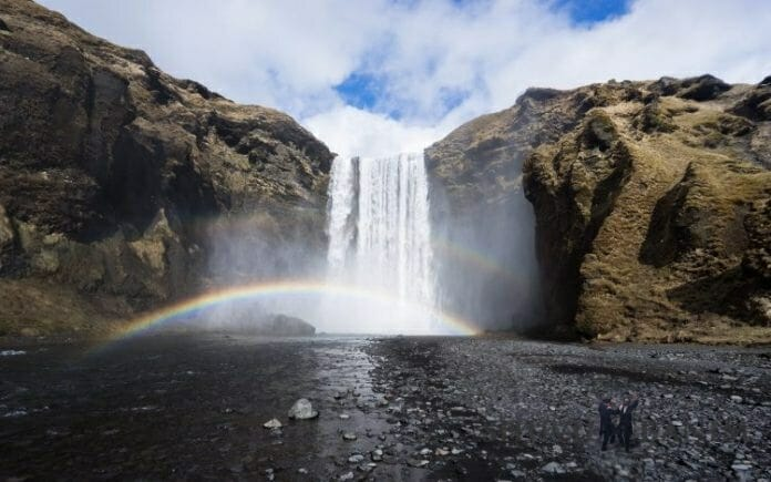 rainbow over a magical waterfall