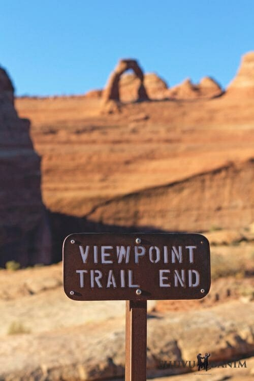 Brown sign in the desert saying: viewpoint trail end