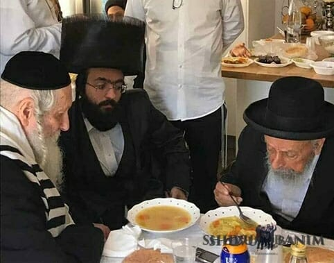 Rav berland and Rav Badani sitting together at a sheva brachos