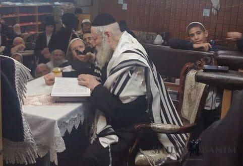 Rabbi Berland sitting and learning Torah