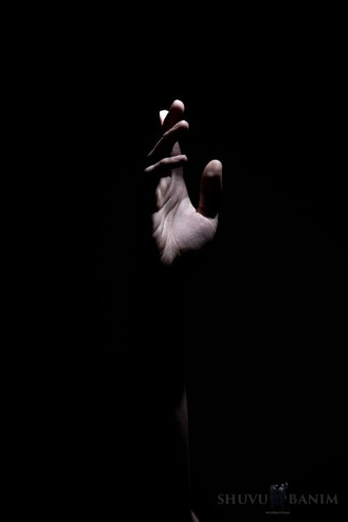 a hand stretching out of the darkness