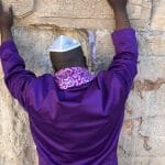 man praying over coronavirus western wall (2)