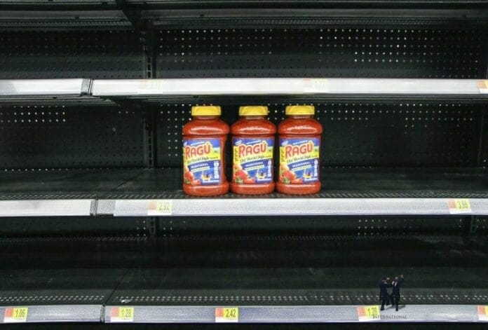 Empty shelves with 3 jars of sauce