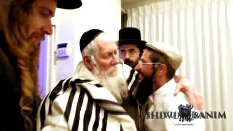 Rav Golan hugs Rav Berland